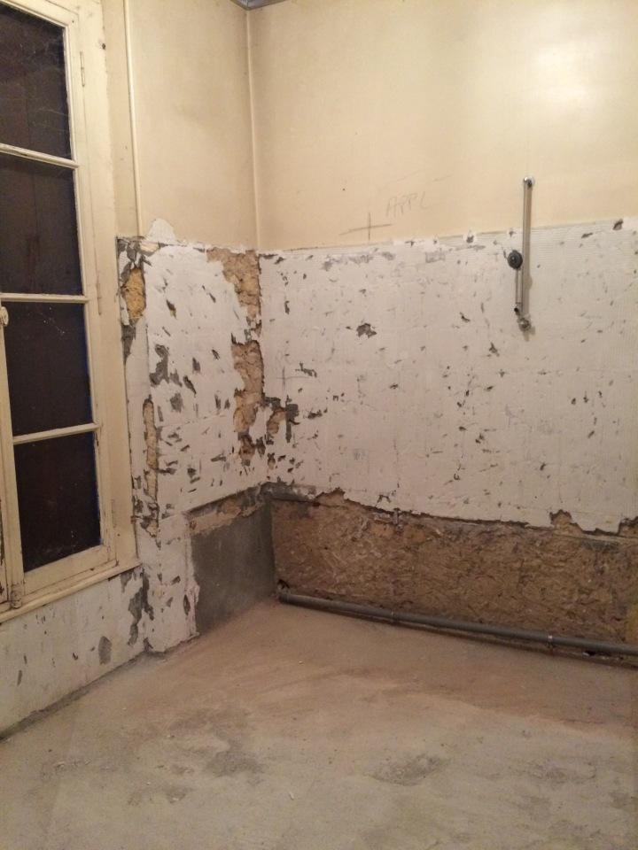 Demolition of old bathroom, limestone walls,