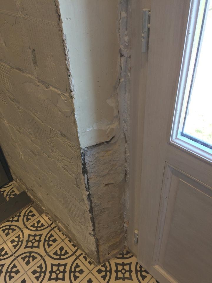 Old limestone, new door, walls to be restored.