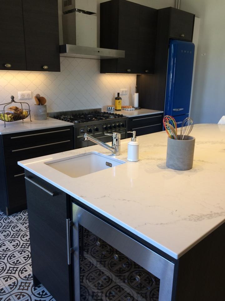 wine fridge, bar sinks, marble counters, working kitchens.
