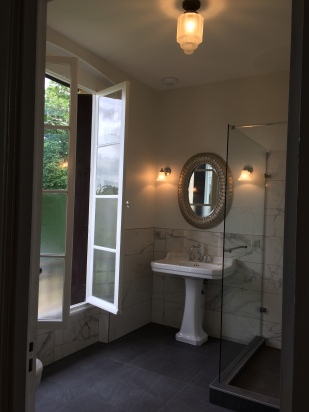 Classic details, beautiful windows, French bathrooms.