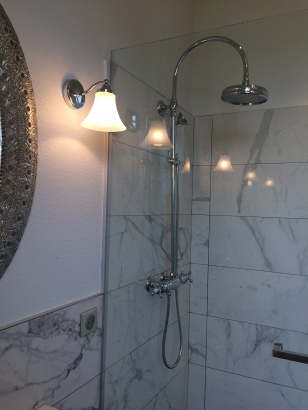 New fixtures, old look; marble shower.