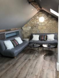 The new seating area with sofas that double as extra sleeping space which allows for up to ten overnight guests in a pinch.