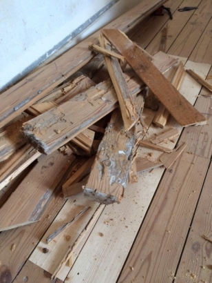 Damaged floor boards after removal.
