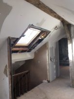 New skylight over the stairwell with entrance to master suite beyond.