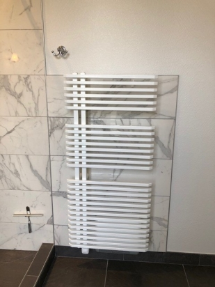 This is the radiator we had issues with - the wall it is mounted on was constructed of clay tile with plaster, so was ill-suited for the weight of the radiator. The addition of the porcelain tile gave the wall the strength needed to support the radiator.