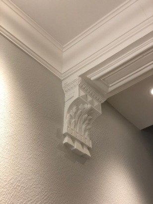 Here, we have preserved the original moulding bracket and added crown, which conceals the wire bundle and adds a nice finishing detail to the ceiling line.